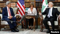 Američki državni sekretar, Džon Keri na sastanku sa iračkim šefom diplomatije, Ibrahimom al Džafrijem u Bagdadu, 10. septembar 2014.