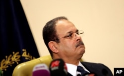 """FILE -- Egyptian Interior Minister Magdy Abdel-Ghaffar appears live on state and private television, in Cairo, Egypt, March 6, 2016. Abdel-Ghaffar warned of a """"conspiratorial scheme"""" by the now-banned Muslim Brotherhood to incite chaos, in comments published in state-owned newspapers."""
