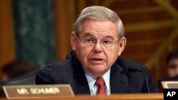 Sen. Robert Menendez, D-N.J. addresses fellow members of the Senate Banking Committee in Washington, Jan. 27, 2015.