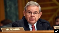 Sen. Robert Menendez, D-N.J. addresses fellow members of the Senate Banking Committee in Washington, Jan. 27, 2015.