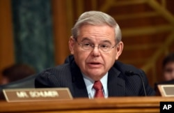 FILE - Sen. Robert Menendez, D-N.J. addresses fellow members of the Senate Banking Committee in Washington, Jan. 27, 2015.