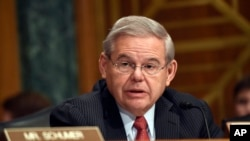 FILE - Sen. Robert Menendez addresses fellow members of the Senate Banking Committee in Washington, Jan. 27, 2015.