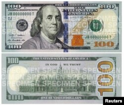 FILE - A combination photo shows the front and back of the newly designed $100 bill.