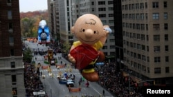 FILE - A Charlie Brown giant balloon makes its way down 6th Avenue during the 90th Macy's Thanksgiving Day Parade in the Manhattan borough of New York, Nov. 24, 2016.