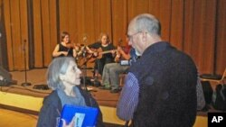 Dyann and Rick Arthur record a performance at the Portland Old-Time Music Gathering.