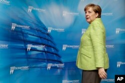 German Chancellor Angela Merkel arrives for a reception of the Economy Council of the German Christian Democratic Party in Berlin, Germany, June 27, 2017.