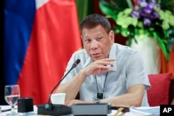 In this photo provided by the Malacanang Presidential Photographers Division, Philippine President Rodrigo Duterte talks at the Malacanang presidential palace in Manila, Philippines, Monday, Sept. 7, 2020. (Karl Norman Alonzo/Malacanang Presidential Photo
