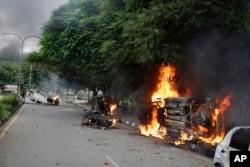Vehicles set alight by Dera Sacha Sauda sect members burn in the streets of Panchkula, India, Aug. 25, 2017.
