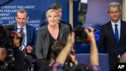 French National Front's Marine Le Pen, center, with Dutch Freedom Party leader Geert Wilders, right, and Austria Freedom Party's Harald Vilimsky gather May 28 after the European elections.