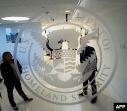 FILE - The Department of Homeland Security logo is seen at one of its annex facilities in Fairfax, Va.