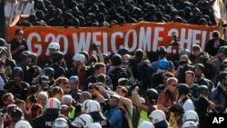 Акция протеста перед началом встречи лидеров стран «Большой двадцатки». Гамбург, Германия