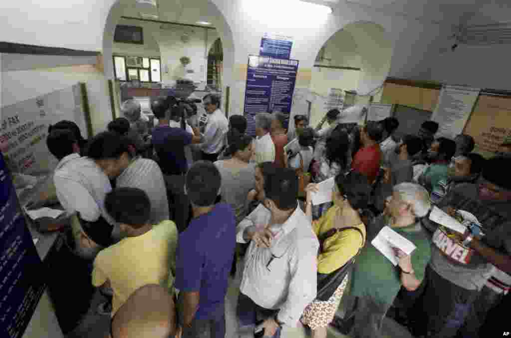 Indians line up to send telegrams on the last day of the service at a telegraph office in New Delhi, July 14, 2013.