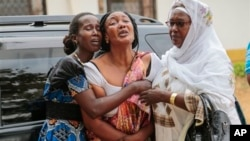 """Relatives and friends grieve during the funeral of Patrick Ndikumana, Friday, July 3, 2015, in Bujumbura, Burundi. According to relatives Ndikumana was killed in the police attack in Jabe neighborhood last week. A U.N. observer mission concluded Thursday that this week's parliamentary elections in Burundi were not """"free, credible and inclusive."""" ((AP Photo/Bertheir Mugiraneza)"""