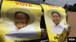 Posters in support of Uganda President Yoweri Museveni are seen at a rally in Kisaasi, a suburb of Kampala, Uganda, Feb. 16, 2016.