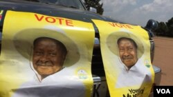 FILE - Posters in support of Ugandan President Yoweri Museveni are seen at a rally in Kisaasi, Feb. 16, 2016. Museveni won the election that month, drawing 60 percent of the vote.
