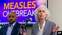 Los Angeles County Department of Public Health experts, Muntu Davis, Health Officer, left, and Director Dr. Barbara Ferrer answer questions regarding the measles response and the quarantine orders during a news conference in Los Angeles Friday, April 26, 2019.