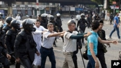 Supporters of ousted President Mohamed Morsi are detained during clashes with riot police in Cairo, Egypt, Sunday, Oct. 6, 2013.
