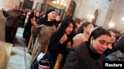 Coptic Christians pray at St Mark Cathedral in Cairo, Dec. 26, 2014.