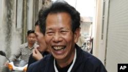 乌坎村代表理事会会长林祖銮与广东省委副书记朱明国谈判归来