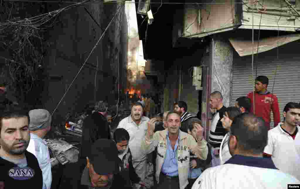 A crowd gathers at the site of a blast in Jaramana district, near Damascus, in this handout photograph released by Syria's national news agency SANA, November 28, 2012.