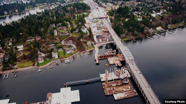 The new SR 520 floating bridge takes shape next to the current bridge in Medina, Washington. Nearly 100 foreign investors, mostly from China, purchased municipal bonds in this project to qualify for U.S. green cards. (Photo courtesy WSDOT)