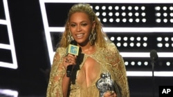 "Beyonce accepts the award for best female video for ""Hold Up"" at the MTV Video Music Awards at Madison Square Garden on Sunday, Aug. 28, 2016."