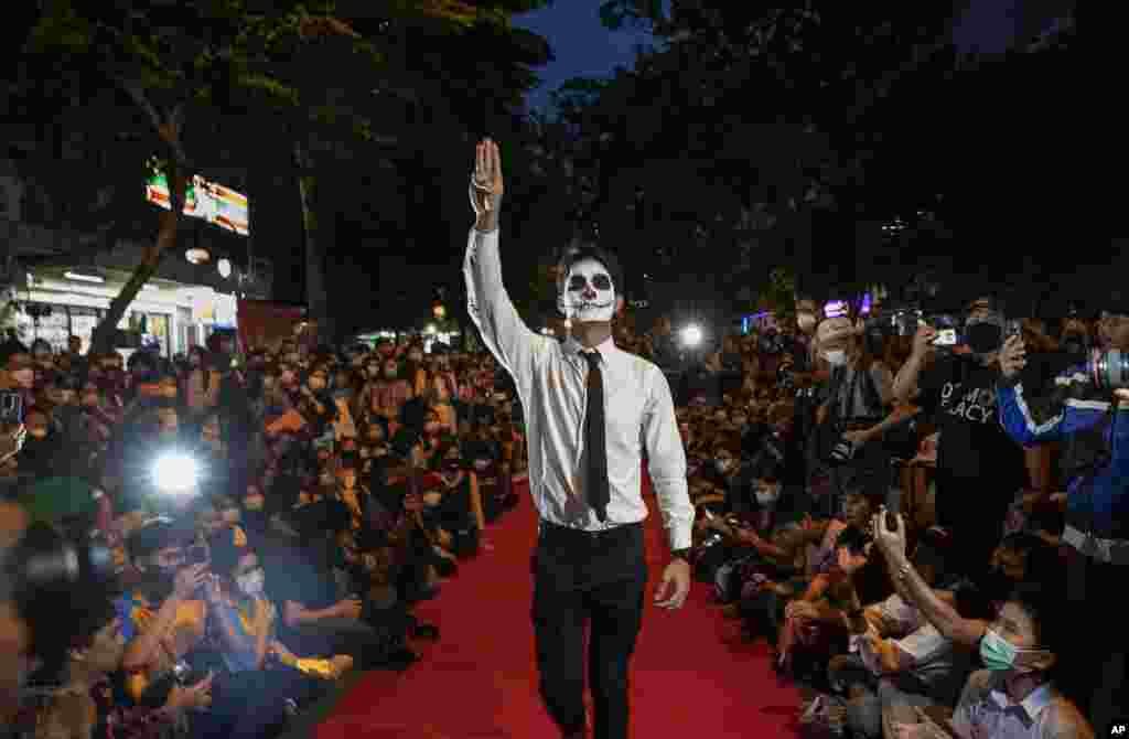 "Pro-democracy protesters perform on a mock ""red carpet"" fashion show billed as a counterpoint to a fashion show being held by one of the monarchy's princesses nearby in Bangkok, Thailand."
