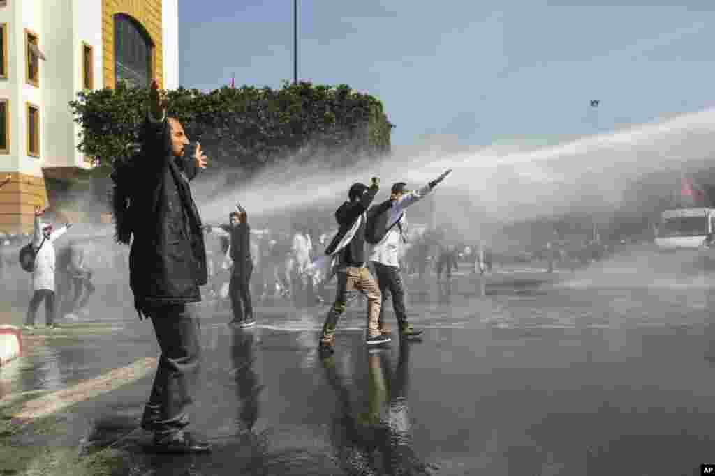 Security forces use water cannon to end a protest by teachers in Rabat, Morocco.