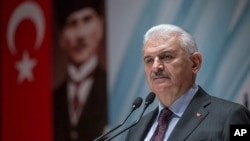 FILE - Turkey's Prime Minister Binali Yildirim speaks to the country's security chiefs in Ankara, Jan. 18, 2018.
