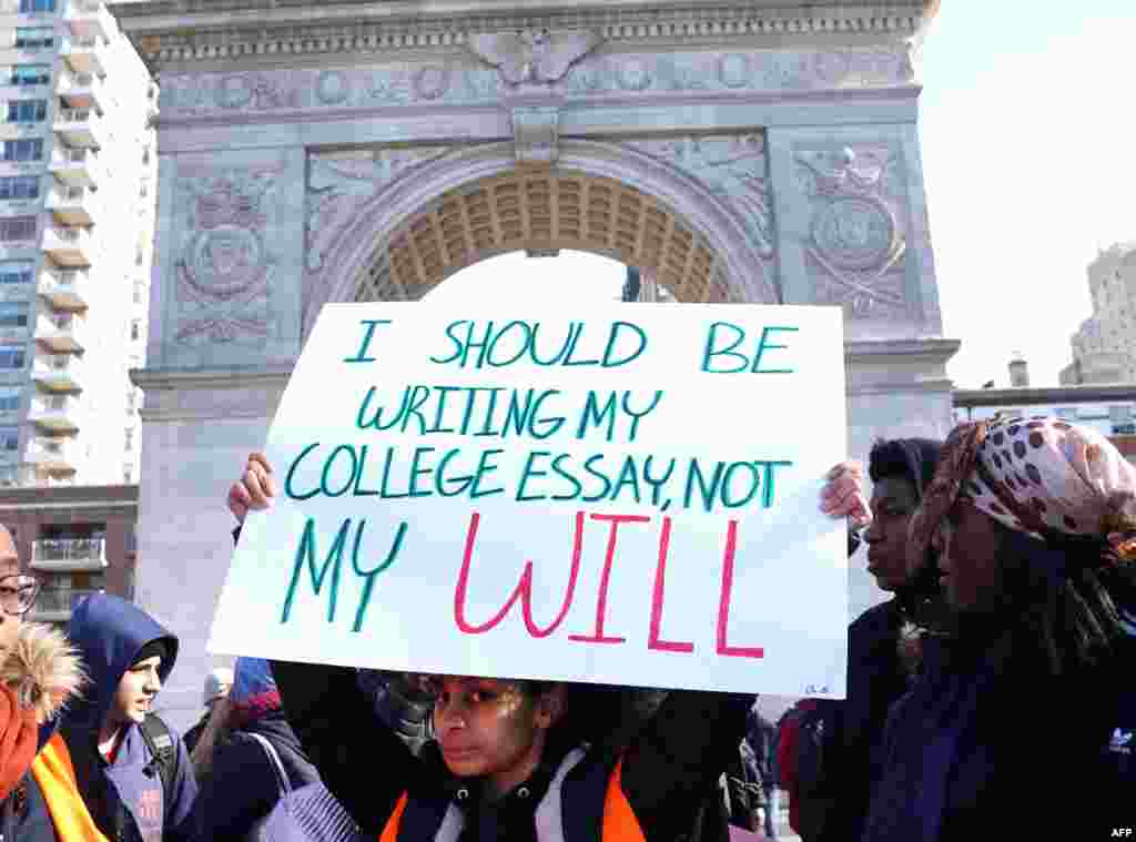 Students from Harvest Collegiate High School stand in Washington Square Park in New York to take part in a national walkout to protest gun violence, one month after the shooting in Parkland, Florida, in which 17 people were killed.