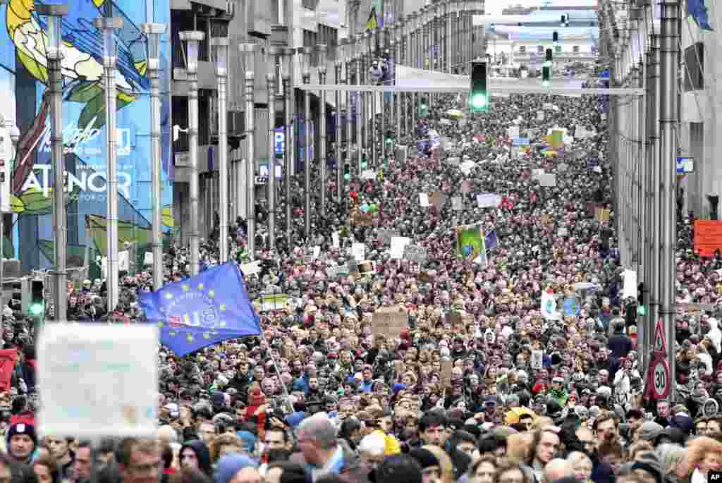 Demonstrators march in the main EU quarter during a 'Claim the Climate' march in Brussels, Belgium. The climate change conference, COP24, will take place in Poland from Dec. 2-14.