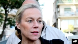 FILE - Sigrid Kaag, the head of the U.N. team charged with destroying Syria's chemical weapons, speaks with reporters in front of the Four Seasons hotel in Damascus, Syria, Oct. 22, 2013.
