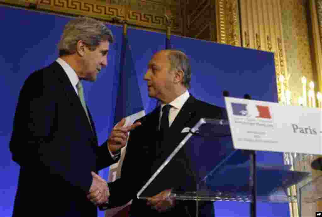 U.S. Secretary of State John Kerry, left, shakes hands after a news conference with French Minister of Foreign Affairs Laurent Fabius at the Foreign Ministry in Paris on Wednesday, Feb. 27, 2013. Paris is the third leg of Kerry's first official overseas t