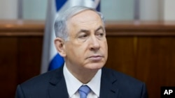 FILE - Israeli Prime Minister Benjamin Netanyahu attends a weekly cabinet meeting in Jerusalem, Jan. 4, 2015. Netanyahu is headed to Washington to give a controversial address to the U.S. Congress.