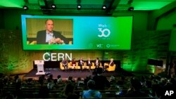 English computer scientist Tim Berners-Lee, 3rd left on the podium, best known as the inventor of the World Wide Web, attends an event at the CERN in Meyrin near Geneva, Switzerland, March 12, 2019. (Fabrice Coffrini/Pool, Keystone via AP)