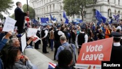 "FILE - Brexit supporters form a counterdemonstration as pro-Europe activists protest during a ""March for Europe"" against the Brexit vote result earlier in the year, in London, Sept. 3, 2016."