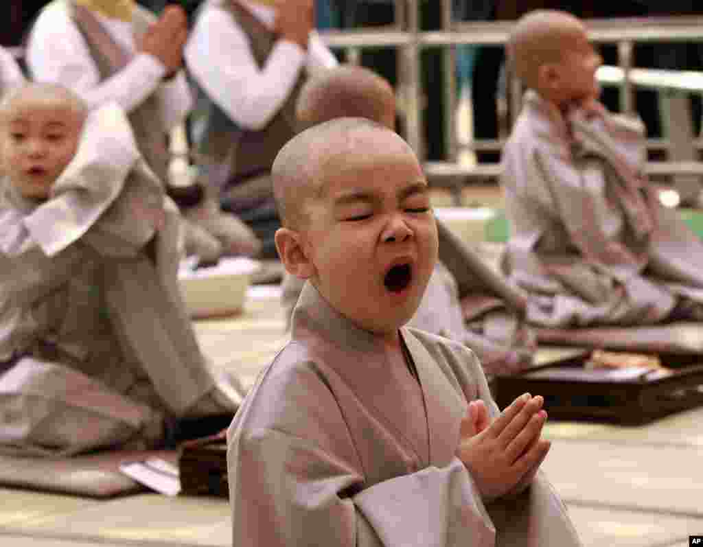 A boy yawns during a ceremony ahead of Buddha's upcoming birthday on May 17 at the Jogye temple in Seoul, South Korea. Ten children entered the temple to have an experience with life as monks which lasts for 16 days.