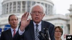 FILE - Sen. Bernie Sanders, I-Vt., center, plans to announce Thursday that he is running for the 2016 Democratic presidential nomination.