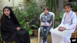 """FILE - This undated frame grab from video provided by Bashar Sakka, producer of the sit-com, """"Um Abdou the Aleppan,"""" shows Syrian actor Qusai Abtini, right, while filming an episode with Rasha, left, known as Umm Abdou, in Aleppo, Syria."""