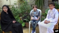 """This undated frame grab from video provided by Bashar Sakka, producer of the sit-com, """"Um Abdou the Aleppan,"""" shows Syrian actor Qusai Abtini, right, while filming an episode with Rasha, left, known as Umm Abdou, in Aleppo, Syria."""