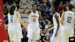 United States' Sylvia Fowles with the team USA during the first half of a women's exhibition basketball game, July 29, 2016, in Bridgeport, Conn.