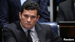FILE - Brazilian federal judge Sergio Moro reacts during a session at the Federal Senate in Brasilia, Brazil, Dec. 1, 2016.