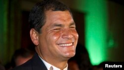 Ecuador's President Rafael Correa reacts after hearing the election results at Carondelet Palace in Quito February 17, 2013. Correa claimed a re-election victory on Sunday that would allow him to strengthen state control over the OPEC nation's economy and