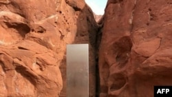 This video grab image obtained Nov. 24, 2020 courtesy of the Utah Department of Public Safety Aero Bureau shows a mysterious metal monolith that was discovered in Utah, Nov. 18, 2020.
