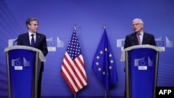 US Secretary of State Antony Blinken (L) and European High Representative of the Union for Foreign Affairs Josep Borrell give a press conference ahead of their meeting at the EU headquarters in Brussels, on March 24, 2021. (Photo by Olivier HOSLET /…