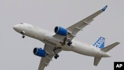 The Bombardier CS 300 performs its demonstration flight during the Paris Air Show, at Le Bourget airport, north of Paris, June 15, 2015.