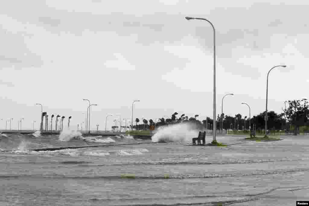 Water floods an area outside the levee system along the shore of Lake Pontchartrain as tropical storm Isaac approaches New Orleans, Louisiana, August 28, 2012.