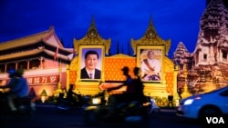 FILE: A decoration of a portrait of Chinese president Xi Jinping, chief of Community Party ( L) and a portrait of Cambodian king Norodom Sihamoni ( R) to welcome president Xi to Cambodia on the corner of Sotharos Blvd and Sihanouk Blvd in Phnom Penh on Thursday, October 13, 2016. (Leng Len/VOA Khmer)