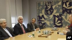 United Nations Secretary- General Ban Ki-moon, right, meets Cypriot President Demetris Christofias, left, and Turkish Cypriot leader Dervis Eroglu, second from left, Thursday, Nov. 18, 2010 at United Nations headquarters. (file)