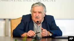 Uruguay's President Jose Mujica speaks during a news conference in Montevideo, Uruguay, Sept. 12, 2014.
